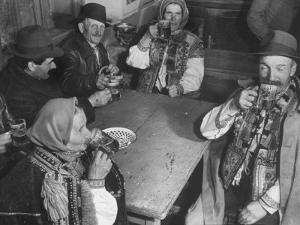 Peasants Drinking Beer in a Village Inn in the Ruthenia Section of the Country by Margaret Bourke-White