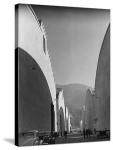People Walking Between Sound Stages at Warner Bros. Studio by Margaret Bourke-White