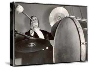 Percussionist Ruben Katz Playing the Bass Drum in the New York Philharmonic by Margaret Bourke-White