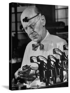 Pistol Engraver Harry Jarvis Disassembling Revolver at Smith and Wesson's Gunmaking Plant by Margaret Bourke-White