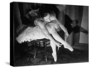 Premier Ballerina Semionova Tying Her Toe Shoe Before a Performance at the Great Theater by Margaret Bourke-White