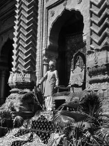 Prince of Khairpur, George Alimurad Khan Talpur, Holding Sword as He Stands in Front of His Throne by Margaret Bourke-White