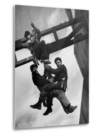 Relief Workers Hanging from Cable in Front of a Giant Beam During the Construction of Fort Peck Dam