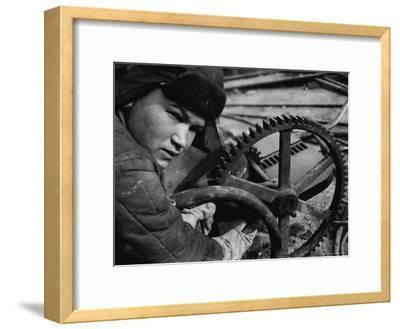 Russian Steel Worker Turning Gear Wheel in a Steel Mill