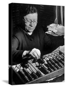 Russian Woman Using an Abacus to Calculate Numbers in Business by Margaret Bourke-White