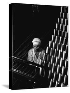 Russian Woman Working at Cloth Weaving Machine in a Textile Mill by Margaret Bourke-White