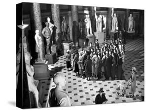 Sightseers Gaping Up at the Sculpture of Great Senators in the US Capitol Building's Hall of Fame by Margaret Bourke-White