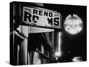 Signs for Reno Rooms, Silver Dollar Club, and Cafe at Night, for Workers of Grand Coulee Dam by Margaret Bourke-White