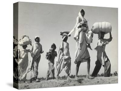 Sikh Carrying His Wife on Shoulders After the Creation of Sikh and Hindu Section of Punjab India