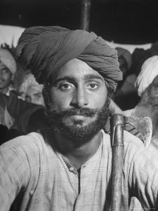 Sikh Listening to Speaker at Rally for a Protest March Regarding Irrigation in the District by Margaret Bourke-White