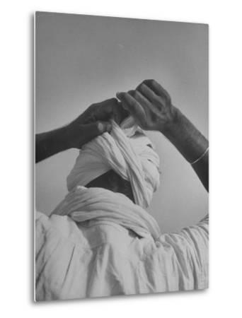 Sikh Man Demonstrating How He Finishes the Winding of His Traditional Turban around His Head