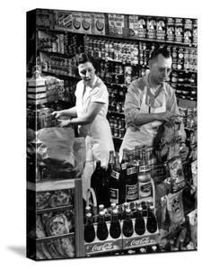 Stan Wentland and Wife Jo Restock Grocery Store, Rockford, Illinois by Margaret Bourke-White