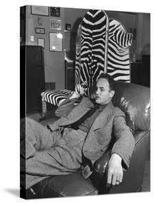 Studio Head Darryl F. Zanuck Relaxing with Cigar in Front of Zebra Skin Screen He Shot in Africa by Margaret Bourke-White
