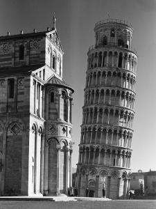 The Famed Leaning Tower of Pisa Standing Beside the Baptistry of the Cathedral by Margaret Bourke-White