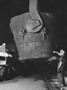 Transfer Car Operator Mae Harris, Signals Craneman to Return Empty, Ladle Bucket to Transfer Car by Margaret Bourke-White