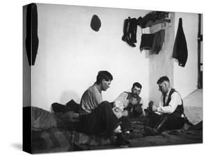 Trio of Czech Peasants Playing Cards in the Season Workers House on the Anyala Farm by Margaret Bourke-White