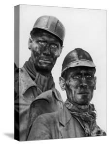 Two Grimy Faced German Coal Miners Posing Resolutely Outside Coal Mine in the Ruhr Valley by Margaret Bourke-White