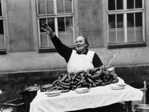 Vendor Trying to Sell Bundles of Sausage by Margaret Bourke-White