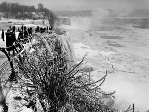 View of Visitors Watching Ice Formations at the American Side of a Frozen Niagara Falls by Margaret Bourke-White