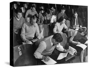 War Veterans and Co-Eds Taking Notes During Classroom Lecture at Crowded University of Iowa by Margaret Bourke-White