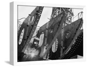 Welder Securing Steel Structure While Working on Hull of a Ship, Bethlehem Shipbuilding Drydock by Margaret Bourke-White