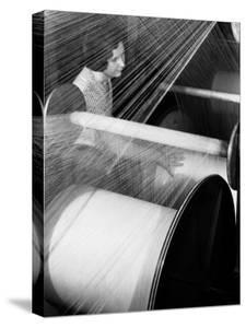 Woman at Loom at American Woolen Mills by Margaret Bourke-White