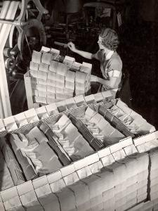 Woman Typing Up Bundles of Paper Bags as They are by Machine Inthe Union Bag and Paper Co. Factory by Margaret Bourke-White