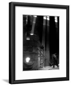 Worker Shoveling Limestone Into an Electric Blast Furnace at Republic Steel Mill by Margaret Bourke-White