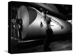 Worker Tearing Off a Sample from a Roll of Paper to Test Its Quality by Margaret Bourke-White