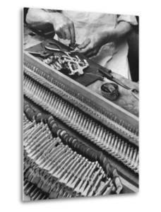 Workman Installing Some of the Whippens, Shanks and Hammers at the Steinway Piano Factory by Margaret Bourke-White