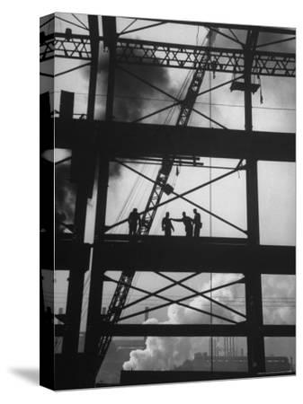 Workmen Against Smokey Sky as They Stand on Girders of the New Carnegie Illinois Steel Plant