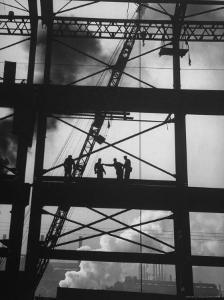 Workmen Against Smokey Sky as They Stand on Girders of the New Carnegie Illinois Steel Plant by Margaret Bourke-White