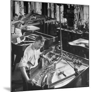 Workmen Installing Steel String Frames Into Grand Piano Cabinets at Steinway Piano Factory by Margaret Bourke-White