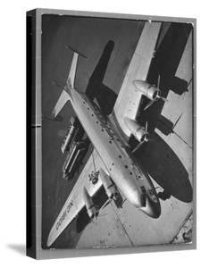 World's Largest Land Transport Plane, the Super Mainliner, a Douglas DC-4 Parked at Airport by Margaret Bourke-White