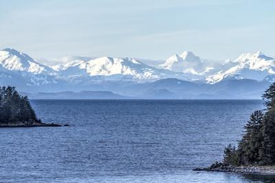 USA, Alaska. Snow covered mountains across Lynn Canal north of Juneau, Alaska.