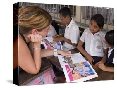 German Volunteer Helping Children with School Work, el Pochote, Near Granada, Granada, Nicaragua