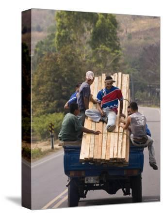 Men Riding on Back of Truck Carrying Timber, Near Esteli, Nicaragua