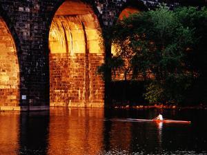 Scull Near Bridge on Schuylkill River, Philadelphia, Pennsylvania by Margie Politzer