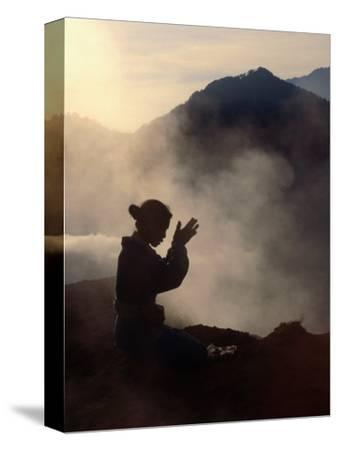 Woman Leaving an Offering on Mt. Batur, Batur, Bali, Indonesia