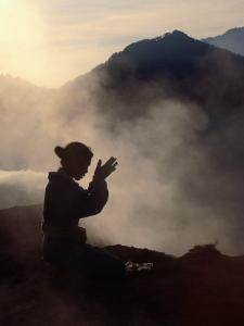 Woman Leaving an Offering on Mt. Batur, Batur, Bali, Indonesia by Margie Politzer