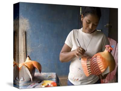 Woman Painting Balsa Wood Sculptures of Chickens, Rio San Juan, Nicaragua