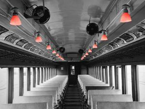 Color Pop, Empty coach of a train, USA, Living Coral by Maria Donovan