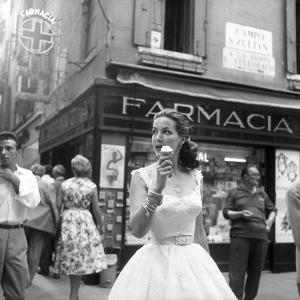 Maria Félix Eating an Ice Cream in Front of a Pharmacy