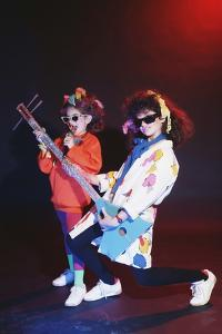 Girls Playing with Musical Instrument by Maria Taglienti-Molinari