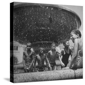 African American Children Playing in a Fountain by Marie Hansen