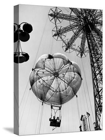 Couple Taking a Ride on the 300 Ft. Parachute Jump at Coney Island Amusement Park