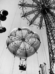 Couple Taking a Ride on the 300 Ft. Parachute Jump at Coney Island Amusement Park by Marie Hansen
