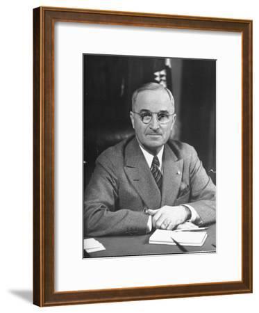 Harry S. Truman Sitting at Desk