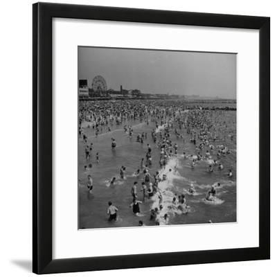 Huge Crowd Gathered in the Surf and at the Beach in Front of Coney Island Amusement Park