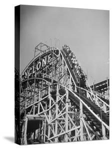 Thrill Seekers at the Top of the Cyclone Roller Coaster at Coney Island Amusement Park by Marie Hansen